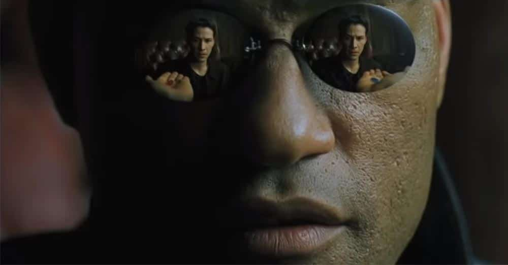 Love more than one person - blue pill and red pill in Morpheus's hand