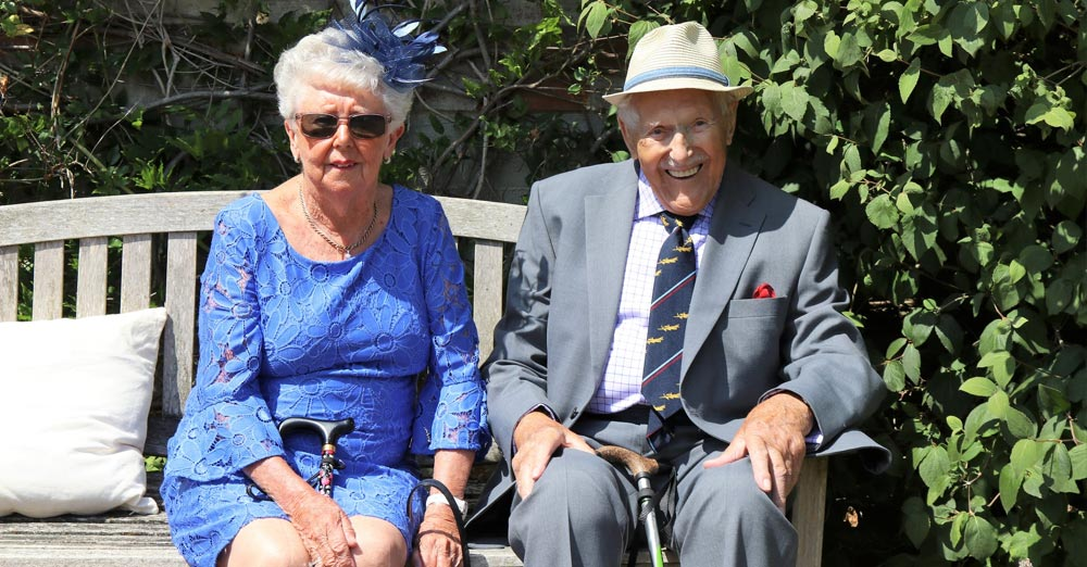 Elder couple sits on a bench